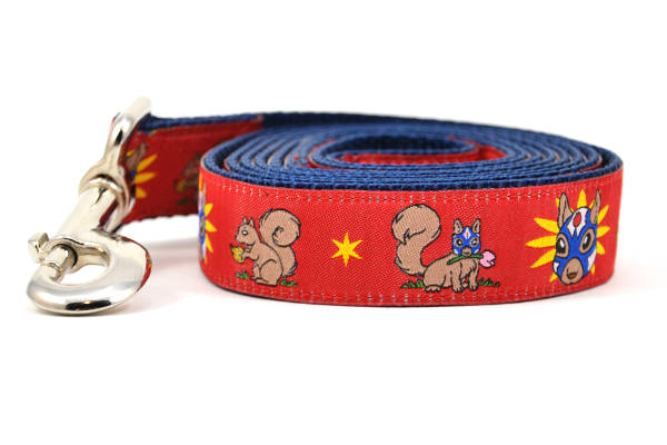 One large red dog leash - design includes squirrel in lucha libre mask with a yellow flower behind it and a tulip on the mask.  One small squirrel with a tulip in its mouth and one with a tulip bulb.  Also, a six pointed star.