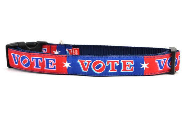 Large dog collar that is red and navy blocks pattern with the word VOTE on each color block.
