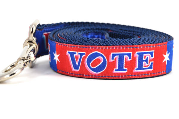 Large dog leash that is red and navy blocks pattern with the word VOTE on each color block.