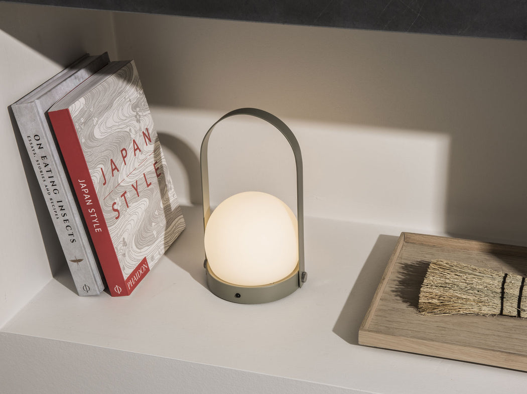 Carrie LED Table Lamp in Olive on Bookshelf