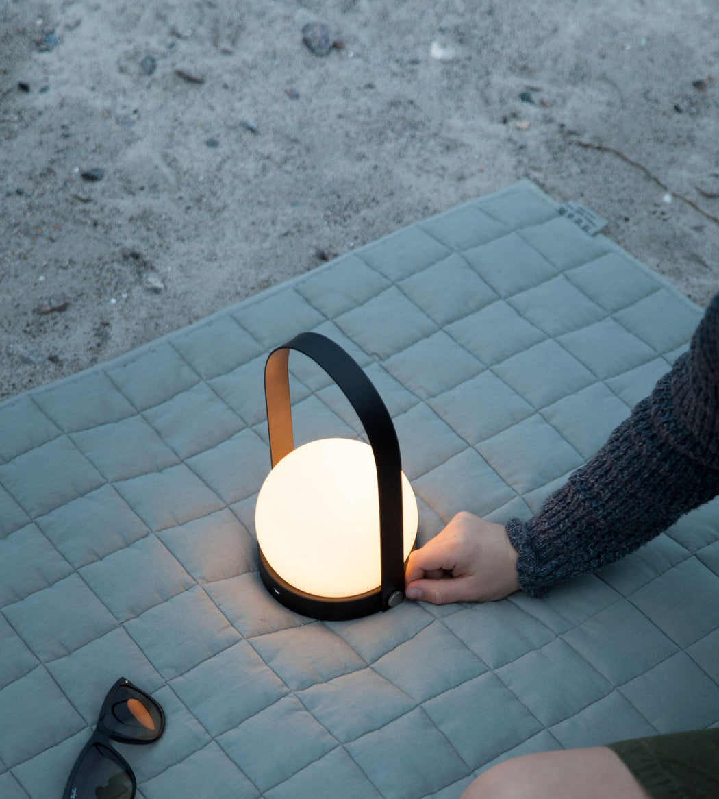 Carrie LED Table Lamp in Black on Beach Blanket