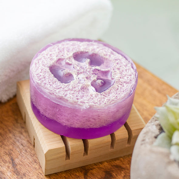 purple luffa soap on cedar soap dish