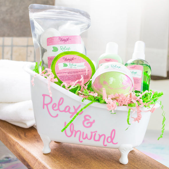 Bathtub gift basket with luffa soap, body spray, lotion, bath bomb, and shower steamers