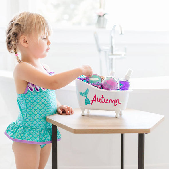Little girl with personalized mermaid bathtub gift set