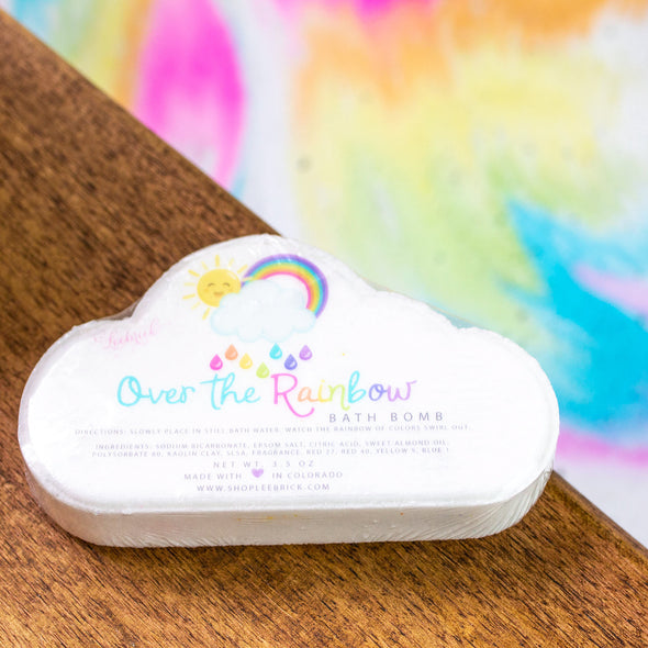 cloud shaped bath bomb with rainbow colors inside