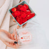 Hands holding a basket of Fresh Picked Strawberry Soaps