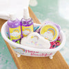 Bath and body essentials in a bathtub shaped gift basket
