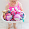 Little girl showing a personalized unicorn bath product gift set