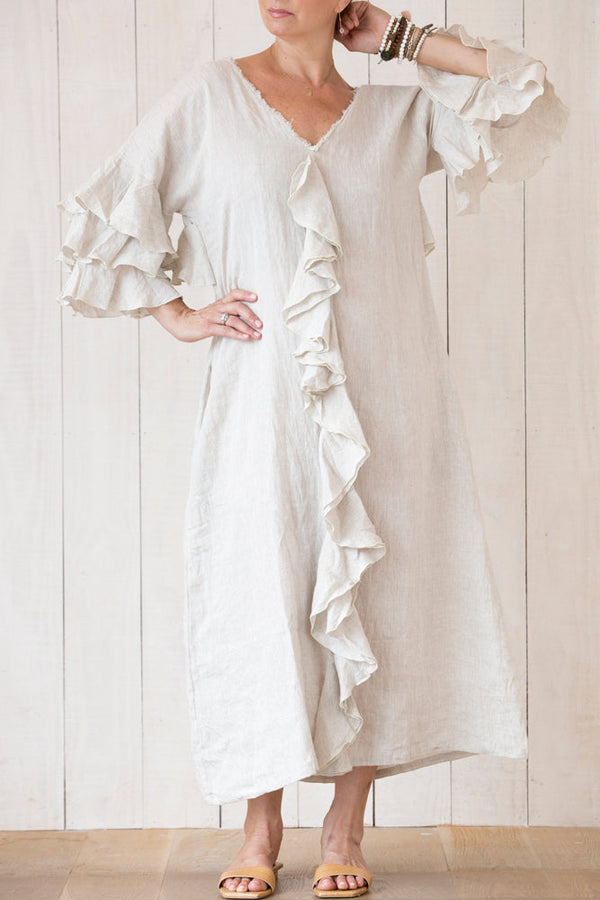 loose linen ankle length dress, with ruffled front and sleeve and side pockets.