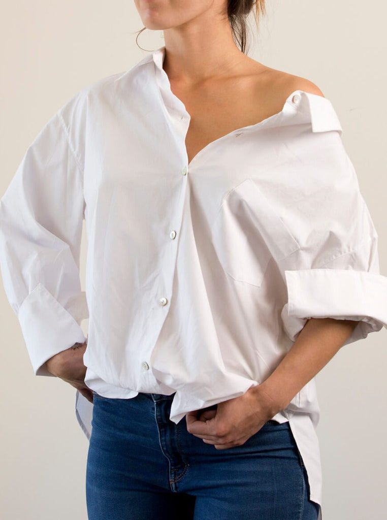 Oversized shirt with collar can be worn off the shoulder, loose or knotted in the front. Huge courtier's cuffs and a changeable grosgrain ribbon back tie make this the fashionista's choice every tim
