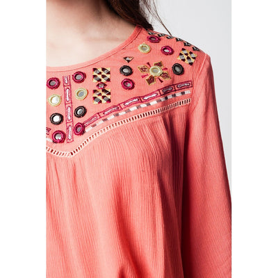 Coral blouse with embroidery detail and wide sleeves