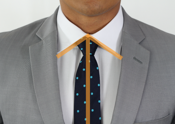 shirt collar and tie act as arrow to point to wearer's face