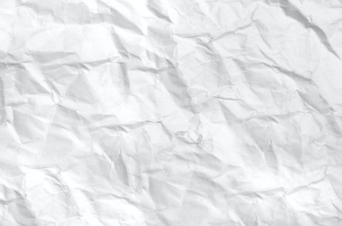 wrinkled paper laying flat on table