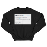 Alexandria Ocasio-Cortez all your base is us tweet on a black crewneck sweater from Tee Tweets