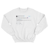Alexandria Ocasio-Cortez all your base is us tweet on a white crewneck sweater from Tee Tweets
