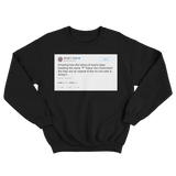 Donald Trump tweet about Jon Stewart's nickname for him on a black crewneck sweater from Tee Tweets