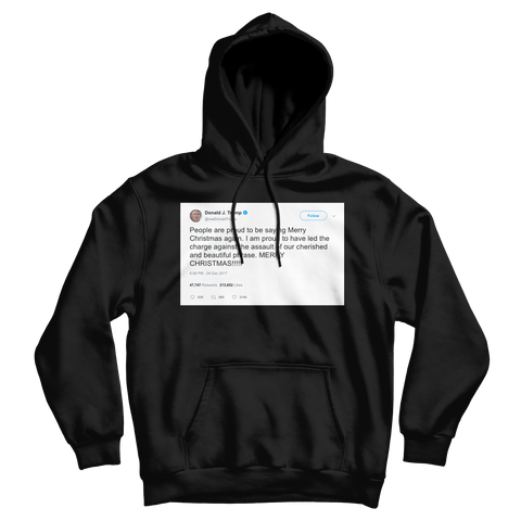 Donald Trump proud to say Merry Christmas again tweet on a black hoodie from Tee Tweets