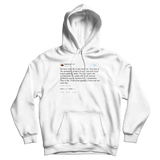 Kanye West be in the moment tweet on a white hoodie from Tee Tweets