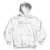Kanye West my single greatest quality is I care tweet on a white hoodie from Tee Tweets