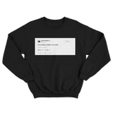 Kanye West not smiling makes me smile tweet on a black crewneck sweater from Tee Tweets