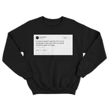 Lady Gaga giving birth to alien on stage tweet on a black crewneck sweater from Tee Tweets