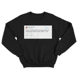 Ricky Gervais God said remove foreskins tweet on a black crewneck sweater from Tee Tweets