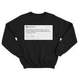 Stephen Colbert RIP Republican healthcare bill tweet on a black crewneck sweater from Tee Tweets
