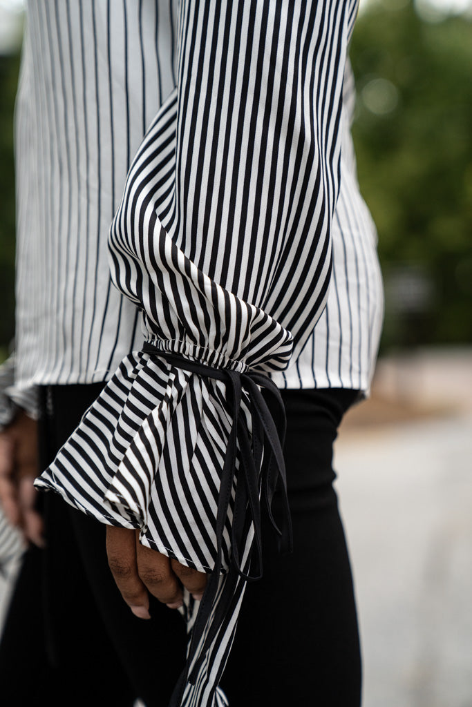 Closeup of sleeve on Striped Tie Cuff Blouse