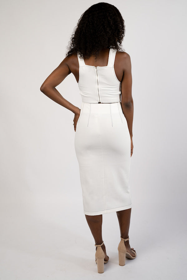 Back view of model wearing white Two-Piece Crop Top and Pencil Skirt Set
