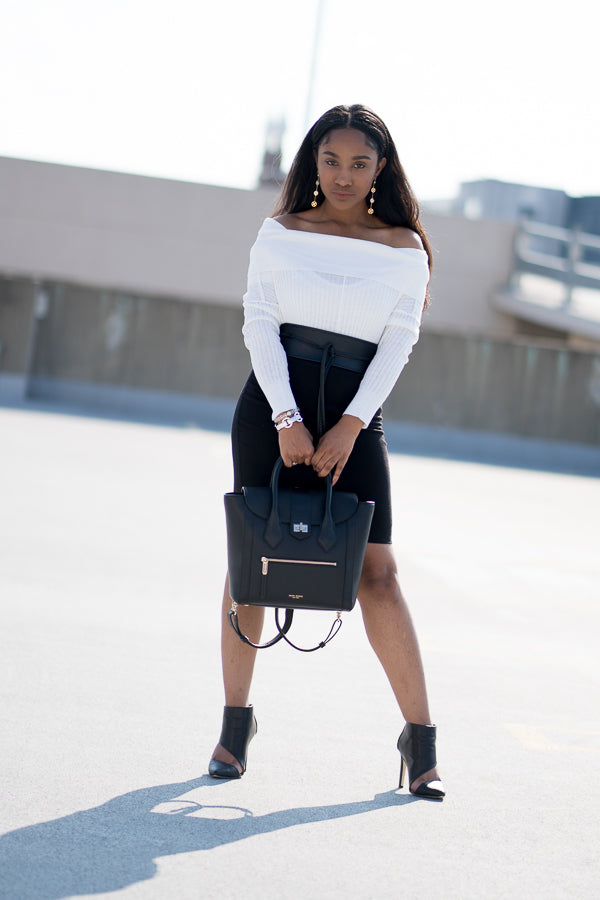 Model wearing white off the shoulder knit Sweater and skirt