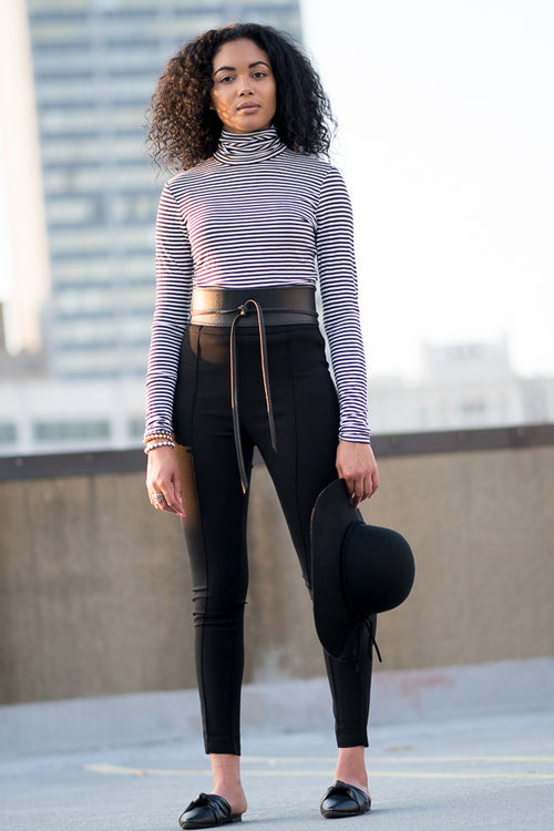 Model wearing High Waist Slim Pant with city skyline in the background