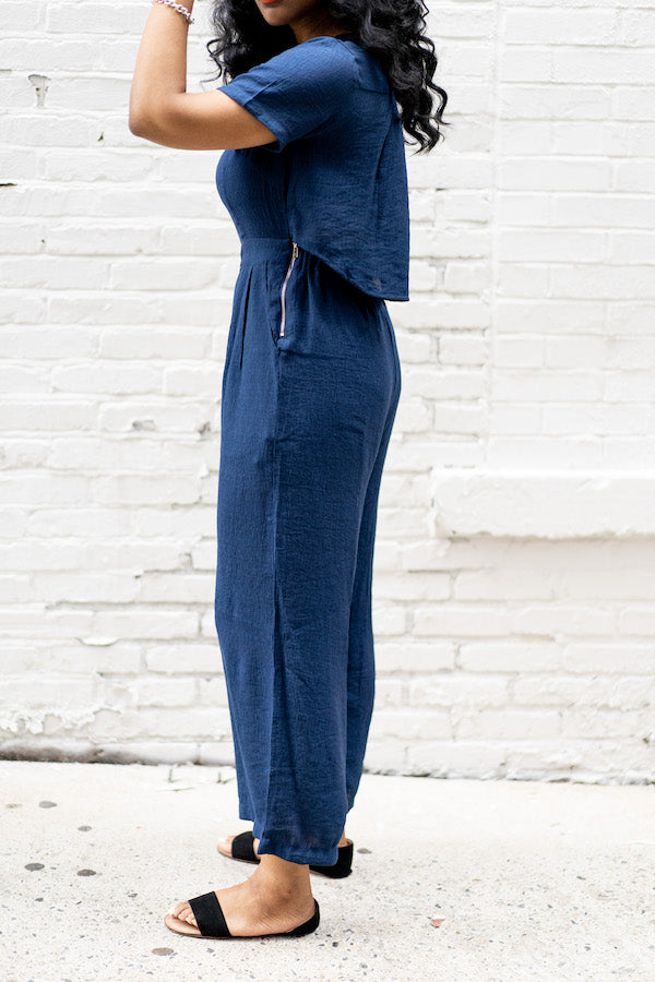 side view of navy button-down back jumper