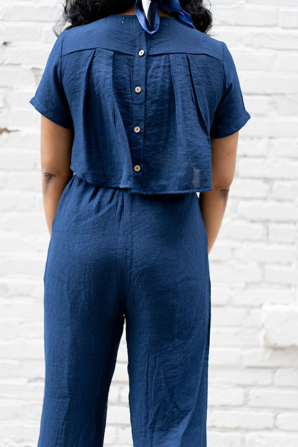 closeup of navy button-down back jumper