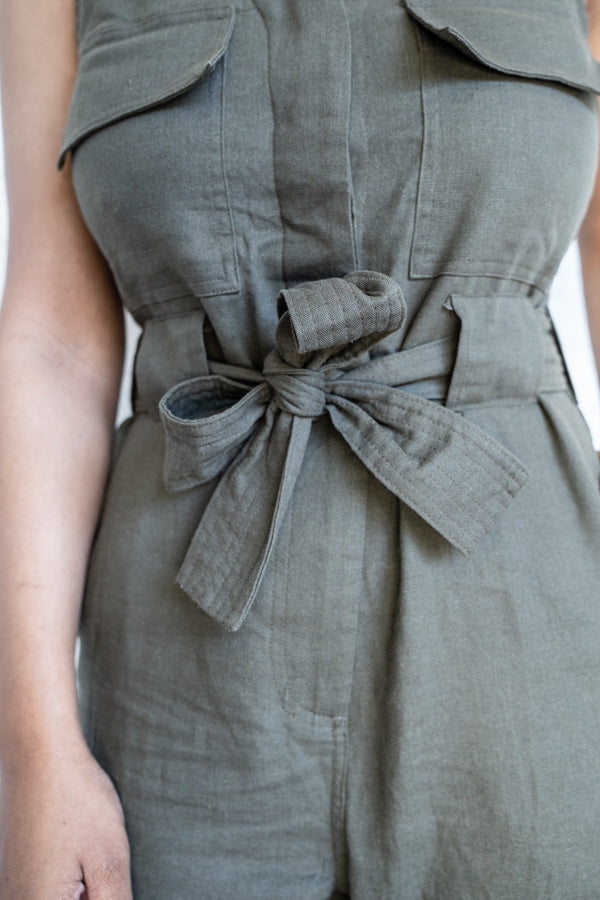 Closeup view of tie-able belt on Utilitarian Sleeveless Jumpsuit