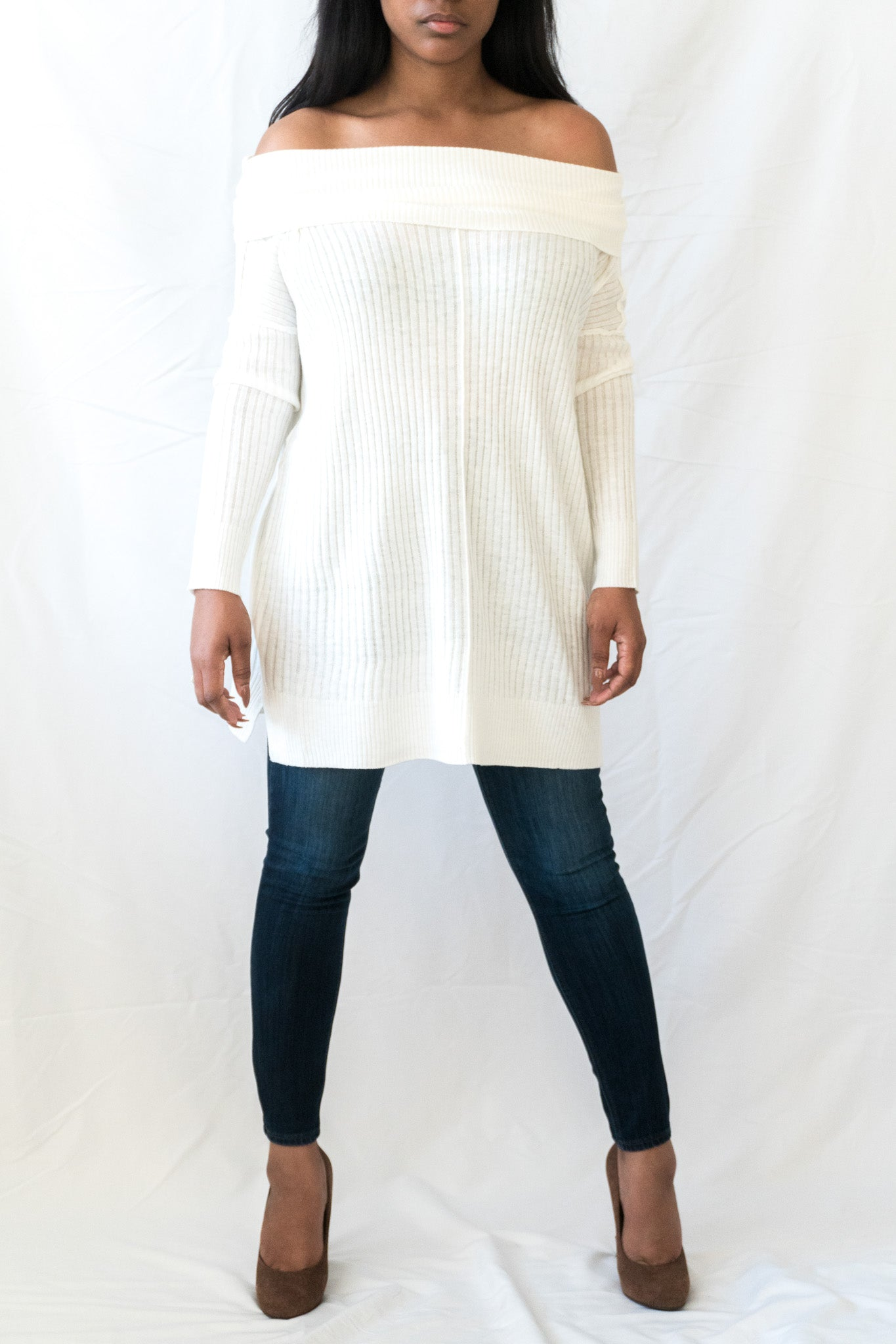 front view of white off the shoulder knit sweater