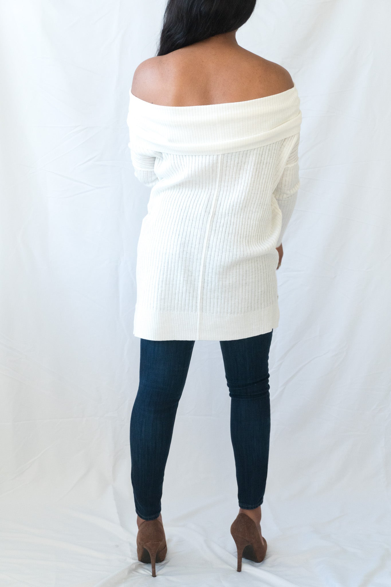 back view of white off the shoulder knit sweater