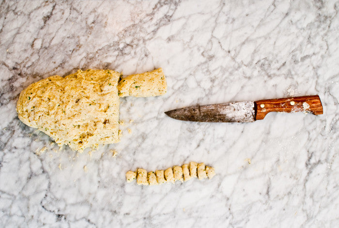 Roll the gnocchi dough into a rope then take a sharp knife and the cut the rope.