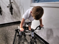 child on bicycle trainer
