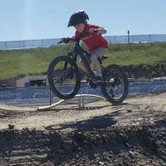 kid jumping mountain bike