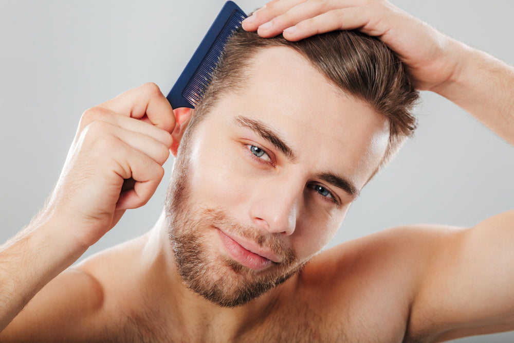 Man combing hair with a plastic comb