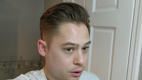 Nick Baker showing the right side of his head with more volume after Lockhart's paradox pomade settled in.