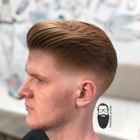 A low bald fade quiff by BarberJustin