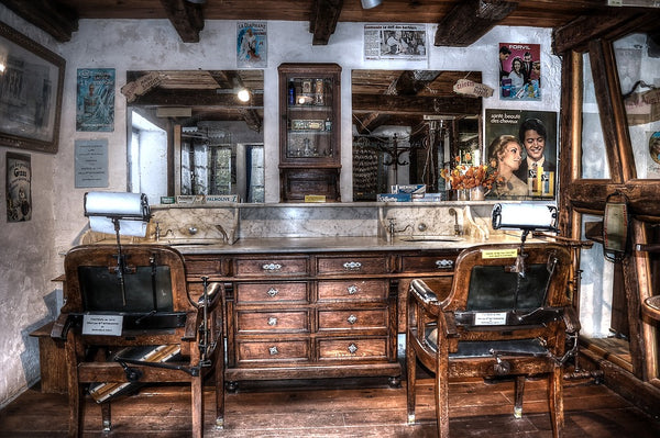 barber shop with old wooden chairs and vintage decor