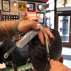 Chuy at Funks Barbershop using a Steeltooth Comb.