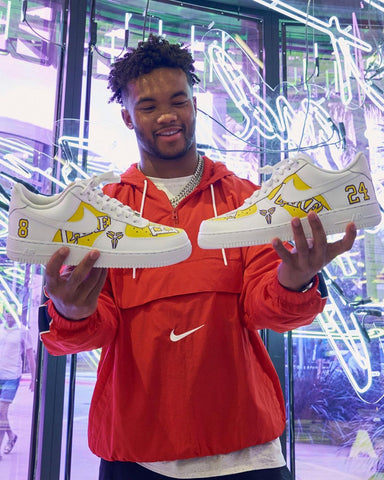 Kyler Murray with kobe bryant shoes and cool hair.