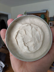 The open lid of Reuzel White clay based matte finish pomade taken in Oak Park, IL by Nick Baker of Steeltooth Combs.