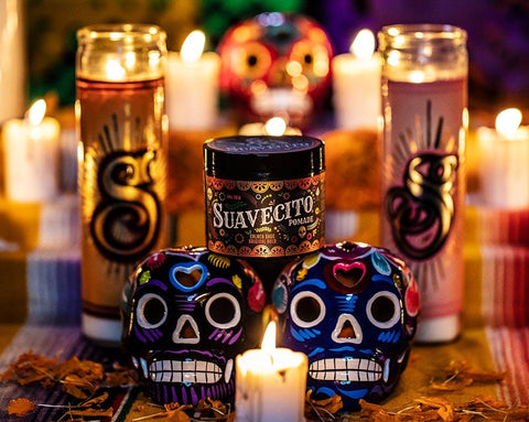 Suavecito Fall edition pomade with candles and a day of the dead theme.