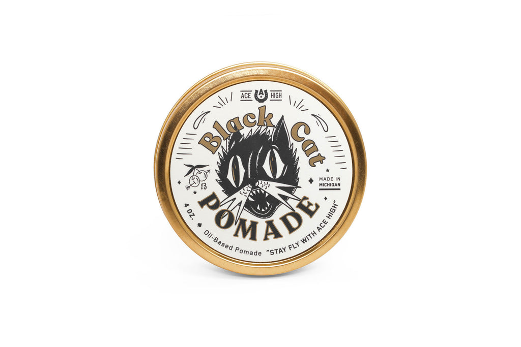 Ace high black cat oil based pomade front view in a gold tin can.