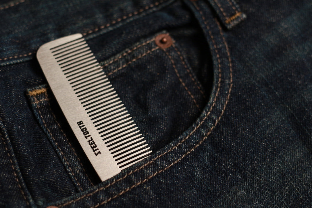 Steeltooth comb in a denim jean pocket.