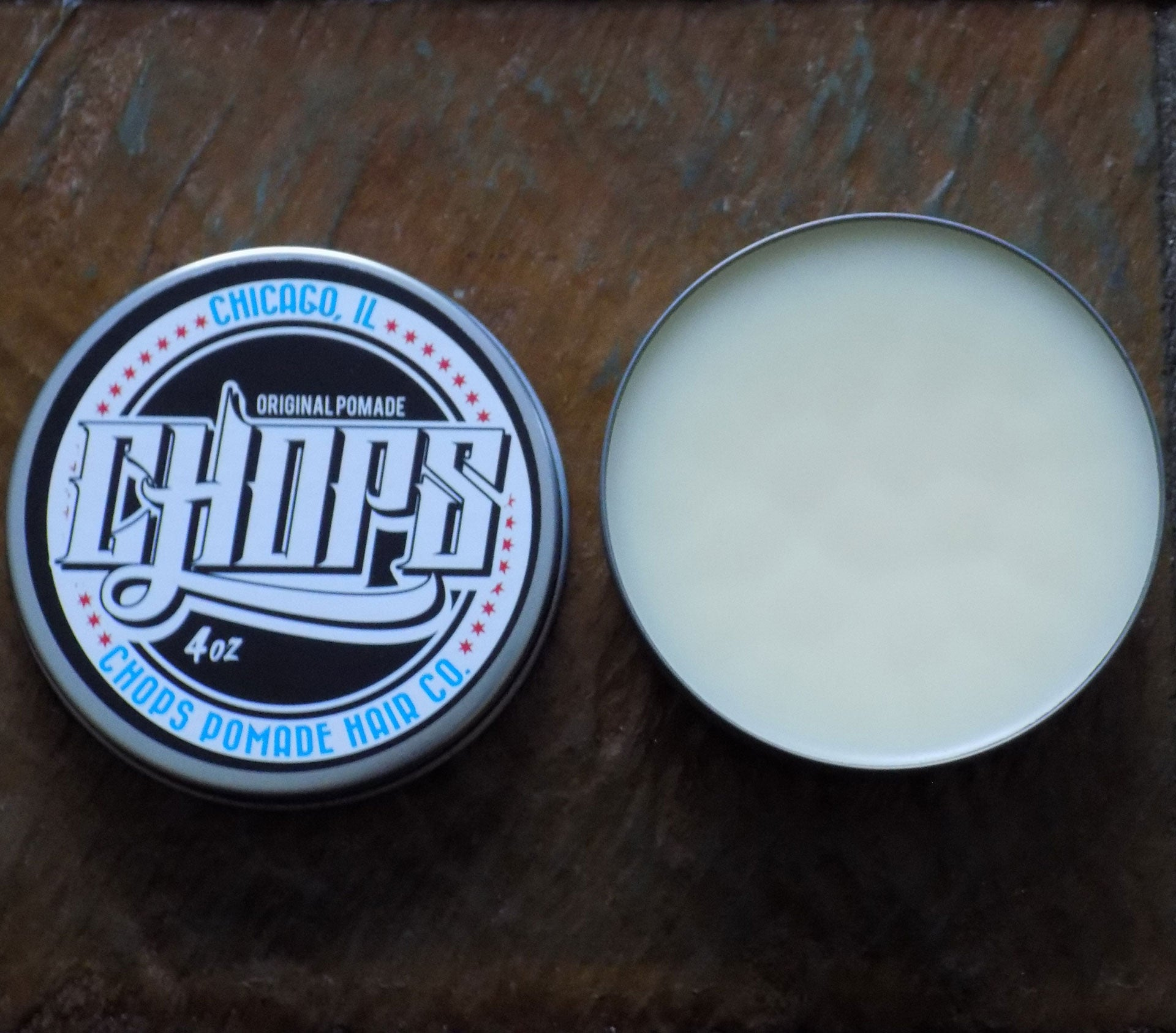 The chops pomade shown without the lid to show the smooth texture of the oil